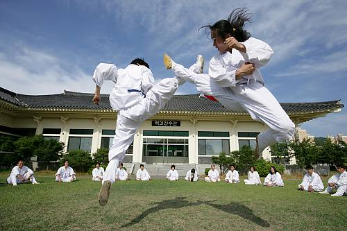 Two practitioners of Taekkyeon, a traditional Korean martial art
