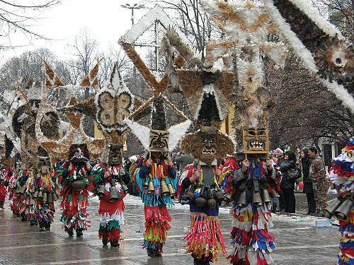 A masquerade group in the Bulgarian village of Meshtitsa at the International Festival of masquerade games 'Surova', Pernik. The masks are made of bird wings and feathers, the costumes are made of fabric cut into fringes