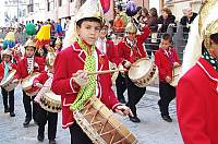 Boys and girls from the 'turba coliblanca' (with-maned group), Baena (Córdoba), playing their drums during Holy Week. They wear a metal helmet with a white horse's mane hanging from it, which is their symbol of identification