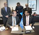 11 COM: signature of the host country agreement
