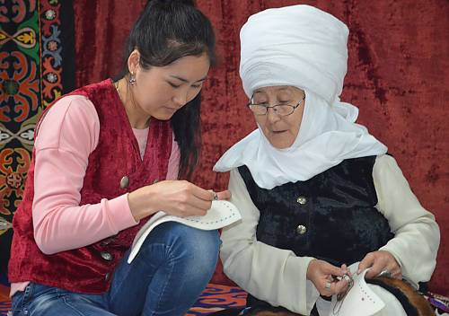 The secrets of crafting transmitted from older generation to younger people. They learn the variety of Ak-kalpak's cut and sewing.