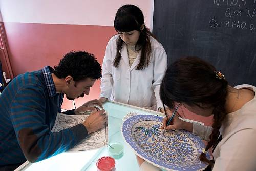 Student decorating a plate in Vocational School of Higher Education at a university in İznik (Bursa)