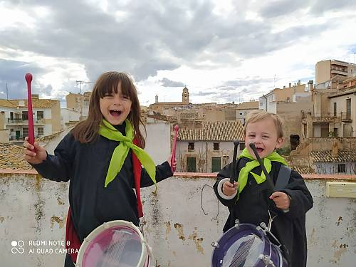 Children beat drums from rooftops as part of tamboradas celebrations in Hellin, Spain, April 2020, which took place from homes this year rather than on the streets.