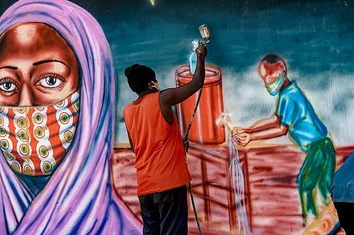 COVID-19 awareness mural in the making in Mwananyamala (Tanzania), painted in collaboration with local artists.
