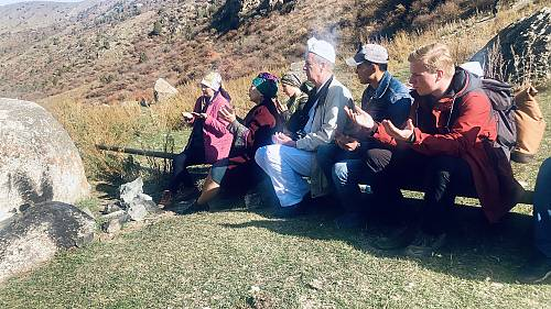 Ritual of candle-lighting in a sacred site, Kyrgyzstan